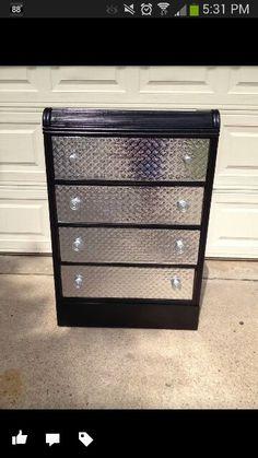 Repurpsed dresser with diamond plating to look like toolbox