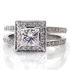 Modern diamond engagement ring has a split shank band and square halo done in micro pave. The center stone is a princess cut and this ring is all sparkle! Princess Cielo from Knox Jewelers