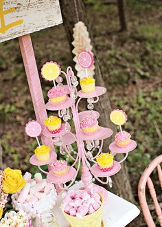 Pink Lemonade Stand birthday party. Repurposed chandelier as a cupcake stand.