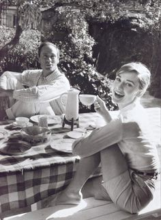 Audrey Hepburn drinking coffee.