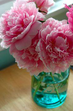 Blue Mason jar fill with pink peonies...