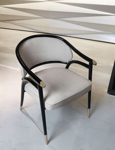 Structure in solid shaped and lacquered polish wood (RAL colours). Backrest in curved upholstered plywood. Seat in padded wood and quilted. Turned aluminium nails and crossbars, and chromed engraved logo in the armrest in gold, bronze or black nickel.
