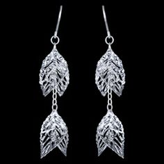 Silver earrings, leaves Silver earrings, Ag 925/1000 - sterling silver. Dangle earrings. Rhodium-plated. Exceptional earrings consist of glittering leaves undulanting in the wind. Dimensions approx. 42x12mm, excluding enclosure. Price per pair.