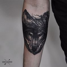 celtic wolf tattoo on the forearm