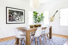 "In the dining room, the <a href=""http://www.apt2b.com/products/lancaster-75-long-dining-table"" target=""_blank"">table</a> and <a href=""http://www.apt2b.com/products/rinaldi-side-chair-white?lssrc=related"" target=""_blank"">dining chairs</a> are super minimalist, but the <a href=""http://www.urbanoutfitters.com/urban/catalog/productdetail.jsp?id=34816975&color=018&category=MORE_IDEAS"" target=""_blank"">diamond-patterned rug</a> really pops."