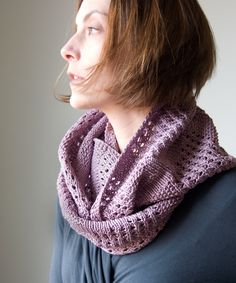 The Canaletto cowl is wide and luxurious, and emphasizes geometric lines and simple textures. Bands of seed stitch and eyelets are intersect...