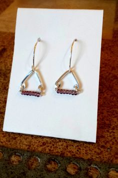 Sterling silver earrings with lavender beading this handmade creations proceeds go toward a well drilling trp to El Salvador.