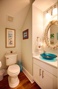coastal bathroom with turquoise sink