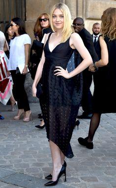 Dior darling! Dakota Fanning opts for an all-black ensemble at Paris Fashion Week.
