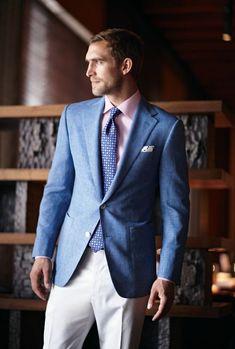 Shop this look on Lookastic:  http://lookastic.com/men/looks/dress-shirt-pocket-square-tie-blazer-dress-pants/9404  — Pink Dress Shirt  — White and Black Polka Dot Pocket Square  — Blue Geometric Tie  — Blue Blazer  — White Dress Pants