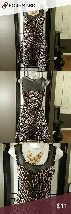 * Almost Famous * Size L Beautiful * Black/Brown Multi-color Animal Print Skater Dress * Sleeveless * Above Knee * Polyester Spandex * Almost Famous Dresses