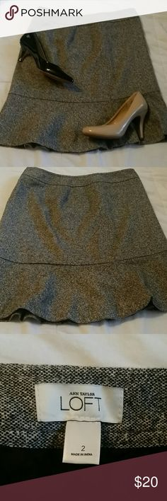 Ann Taylor Loft tweed lined skirt Gorgeous new without tags ruffled bottom skirt. 40% wool 32% polyester 12%silk 10%acrylic 2%spandex 2%other fiber shell. Lining is 100% acetate. Skirt is a side zipper. Beautiful for the office or for out and about! Ann Taylor Loft  Skirts