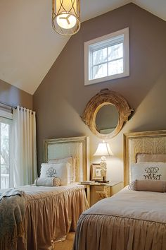 Gorgeous neutral room! Details I love - Warm grey wall color, draperies are simple cream grommet top, soft patterned headboard fabric, monogram pillows, pretty lighting and mirror details, neutral bedding