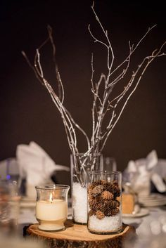 Faux snow winter wedding centerpieces with log slices, twigs, candles, and pine… Stick Centerpieces, Winter Wedding Centerpieces, Diy Wedding Decorations, Homemade Centerpieces, Winter Wonderland Decorations, Winter Wonderland Wedding, Vases, Rustic Wedding Backdrops, Faux Snow