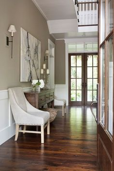 dark floors, white trim, grey/beige walls, white/cream/black/wood/natural accent pieces