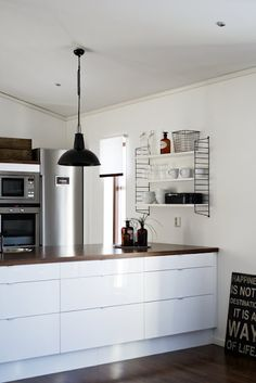 kitchen island and string shelves