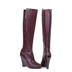 https://www.cityblis.com/7744/item/13624  Benedetta wine - $495 by monica stalvang  Wine-red wedge knee boot in leather and patent leather.  -110 mm high heel -15 mm external platform -Almond shaped toe -Patent leather  covered wedge -Trims in patent leather -Back zip closure -Leather insole and lining -Made in Italy -80% calfskin, 20% lambskin