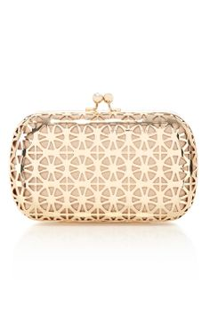 The Cali Cut out Bag is a perfectly proportioned bag with a stunning gold toned metal surface. Featuring a modern geo cut out technique this fabulous bag showcases expert craftsmanship. This fully lined bag comes with a detachable snake chain for versatile wearing.