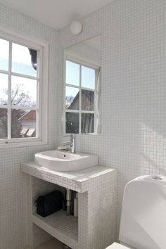 white mosaic tiles in bathroom. How easy is it to build one of these sinks? Anyone know?