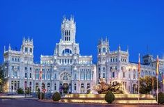 Plaza de la Cibeles, where three of Madrid's most affluent neighborhoods (Centro, Retiro, and Salamanca) intersect, is both an epicenter of municipal grandeur and a crash-course in Spanish architecture.