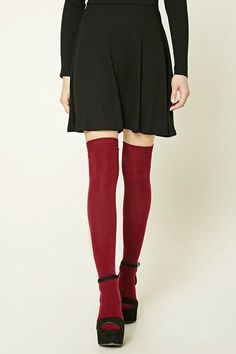 1042e9158 A pair of knit over-the-knee socks crafted from a wool blend and