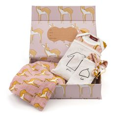 The all in one, adorable newborn gift set: The set includes one swaddle blanket, one newborn gown, and one newborn hat. Packaged in a keepsake box, the couple will receive an ultra-soft outfit for the