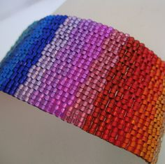 Rainbow peyote stitched bracelet - good way to use up bits of color