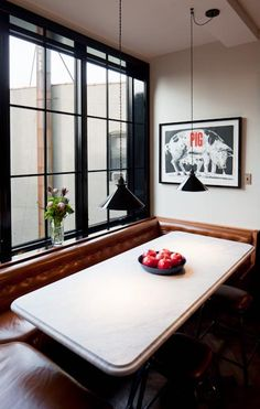 Love this banquette - warm and euro.