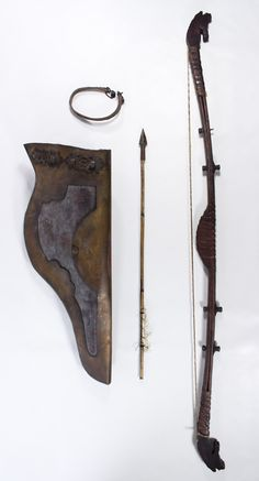 Lot 237: Asian Bow, Quiver and Arrow; Three items including a wood, leather and brass bow with carved horse head ends, a brass and leather quiver with extra strap and a notched bamboo arrow with metal tip