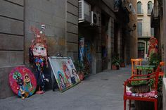 Is an artist. And entering her store/workshop is like entering another world. Cavernous and creative, it's filled with brightly coloured, wide-eyed women (her trademark paintings). Shopping In Barcelona, Another World, Bright Colors, Workshop, Paintings, Store, Creative, Artist, Women