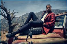 Actor Armie Hammer wears a red and black plaid Gucci coat, an Etro jacket, Joe's henley, and Tom Ford pants.