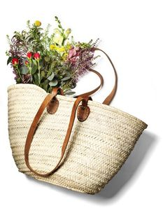 """This easy, simple market basket has both short and long leather handles. Woven from Palm leaf, it is both sturdy and flexible. Perfect for shopping trips, storage, the beach, or the garden. 12""""x18 Photocourtesy of Bon Appetit Magazine for White Nest Market ."""