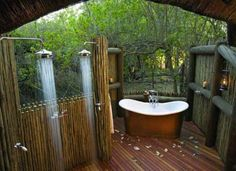 Solar heated outdoor shower and bathtub. I want!!