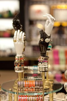 hand forms bedecked in accessories @Henri Bendel