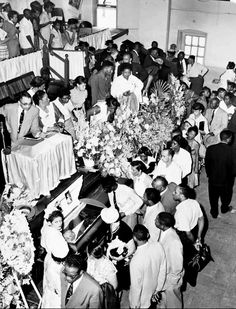 Mourners pass the casket of 14-year-old Emmett Louis Till (July 25, 1941 –…