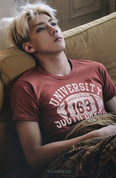 The word 'University' really matches with the feeling of the photo. Imagine Sehunnie after a tiring day at university. He arrives home and throws himself on the sofa, watches the TV and daydreams about his secret crush, his noona