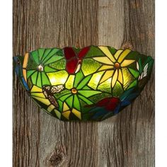 """Assembled Dimensions: 14.5""""W x 8""""D x 9.25""""H Stained glass sconce in half moon shape with rain forest flowers Elegant & Tiffany inspired Easy to hang back plate contains 8 long-lasting white LEDs Powered by 3D batteries (not included) 4 stage dimmer allows you to choose brightness level (25%, 50%, 75%, 100%) Feature Led Wall Sconce, Wall Sconces, Battery Operated Wall Sconce, Forest Flowers, Moon Shapes, Back Plate, Hanging Pictures, Bright Lights, Stained Glass"""