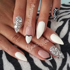Stiletto nails - I love the heart at the bottom of the nail idea.