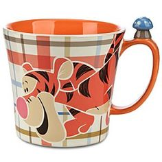 Disney Tigger Mug   Disney StoreTigger Mug - Put a spring in your step each morning with a stimulating sip from our happy hot beverage mug boasting bouncy Tigger graphics and a tiny sculptured mushroom on the handle.