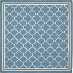 A quatrefoil motif blue and white Courtyard rug by Safavieh, shown in square size.