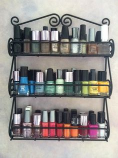 Spice rack turned nail polish holder.  I WANT THIS!!  Now to find a spice rack to mount on my linen closet door.