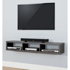 The functional and upscale appearance of this wall mounted TV console will create a modern look in your home.