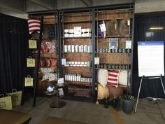 Our Elon bookcase display looking elegant at the #DenverFlea with candles, pillows, and Zents products.