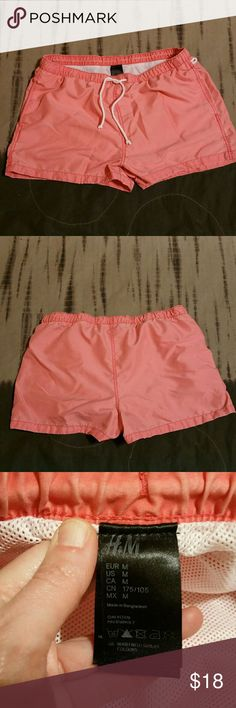 H&M shorts size M Cool peachy orange color. Lined with mesh. Waist measures 16 across (also has elastic and a drawstring) 12 inches long. H&M Shorts