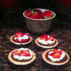Chocolate & Strawberries yum....mini chocolate pudding pies with whip cream and diced strawberries....an easy quick dessert