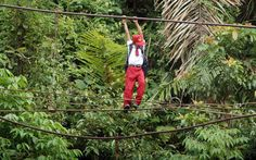 The Journey These Students Take to School Will Make You Value Education -Children from Batu Busuk village in Sumatra, Indonesia, tightrope walk 30 feet above a flowing river, followed by a 7-mile walk.