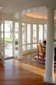 Great dining room with curved windows and glass door leading to the back deck.