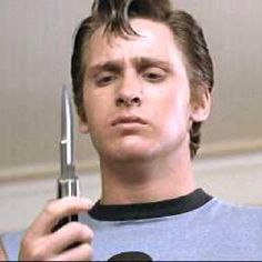 """Dally: """"You got yer knife?"""" Two-Bit: """"What?"""" Dally: """"The KNIFE. Give me it, will ya?"""" Two-Bit: *hands over knife* Dally: """"You know that rumble tonight? We gotta get EVEN with those Socs. Let's do it for Johnny, man. We'll do it for Johnny!"""""""