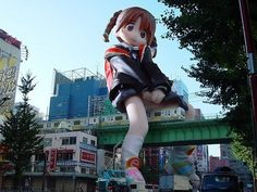 The train goes under her skirt! Only in Japan would you see this kind of crazy advertising. Love it!