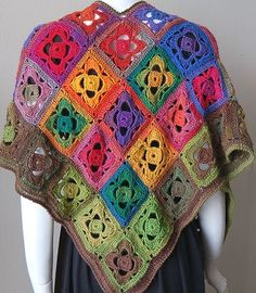 This mini mochi flower garden shawl is one of the most beautiful crochet patterns you will ever see. The different colors and designs are eye-catching and the yarn used is just so pretty.